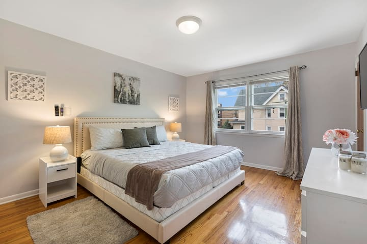 """Our master bedroom features a king sized, memory foam mattress, and a 40"""" 4KTV with Roku device connected."""