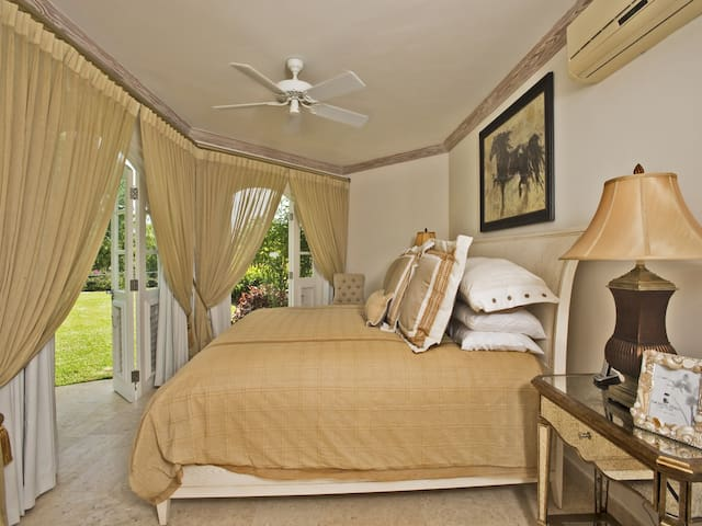 The second bedroom with a queen bed, A/C, and a ceiling fan to keep you cool and comfortable