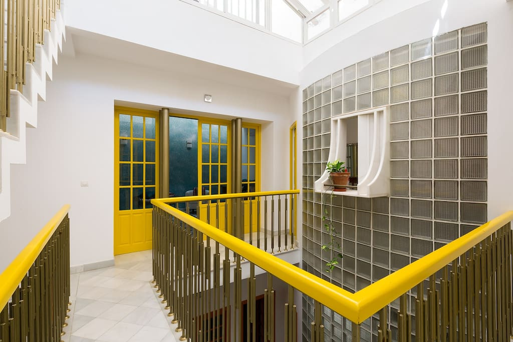 Second floor (yellow). On this level there is 1 bedroom, 1 bathroom and the living room.