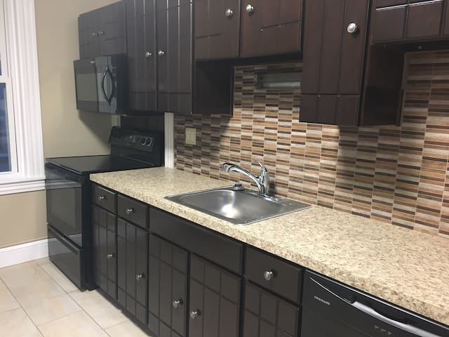 Newly remodeled kitchen with stove, refrigerator, dishwasher and microwave
