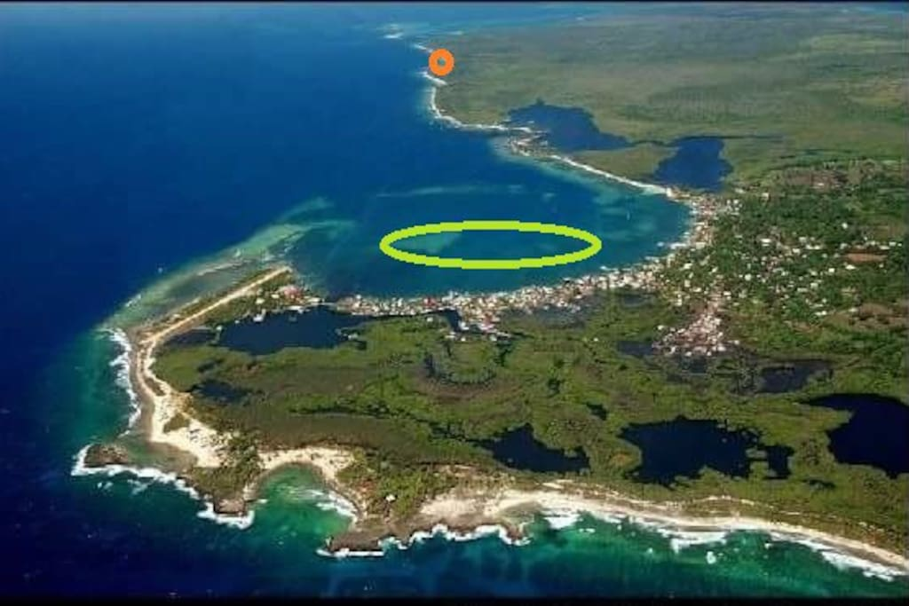 Utila Islands looking west. Green circle indicates commercial center of East Harbor. Orange Circle shows location of Parrotfish Reef House at Jack Neal Beach on South Shore.  Parrotfish Reef House, is located 15 minutes from East Harbor and reached by BOAT ACCESS ONLY.