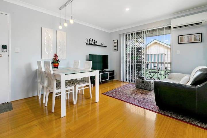 The unit is fresh, light and clean with bamboo flooring throughout.  A small balcony with outdoor seating opens from the living area.
