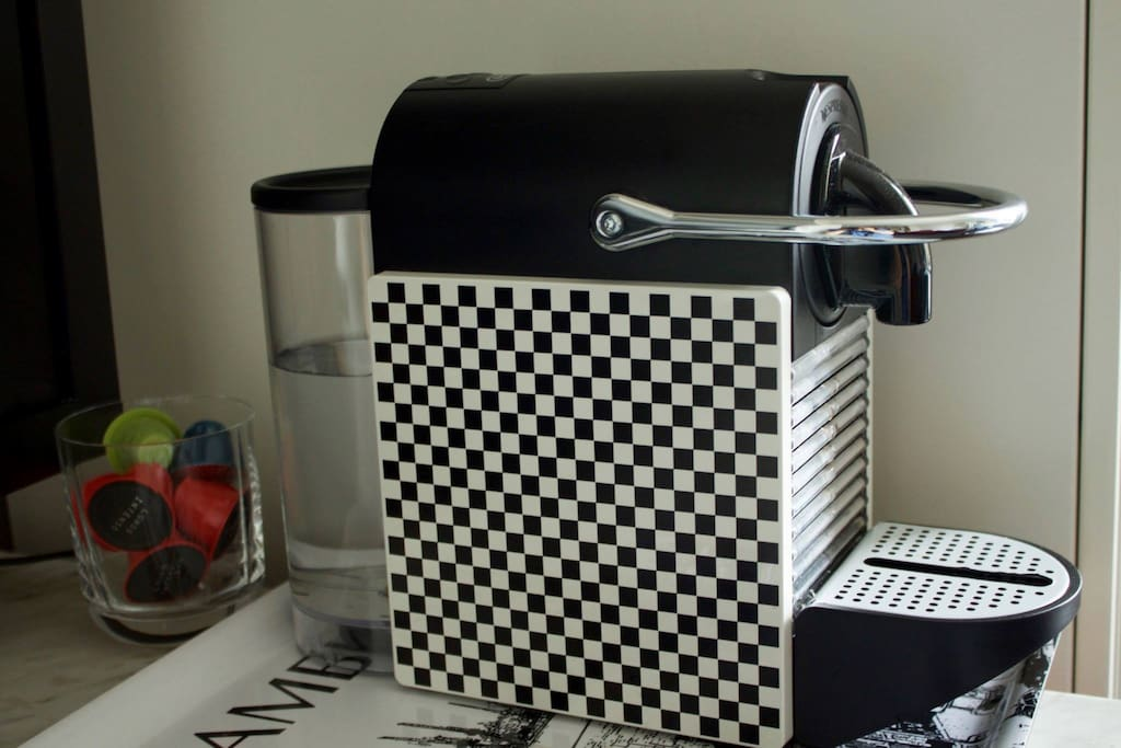 There is a Nespresso machine in your room :-)