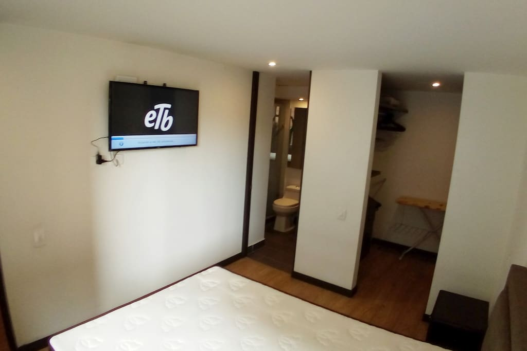 """Main bedroom, TV 42 """", Private Bathroom, with a lot of storage space beside the bed."""