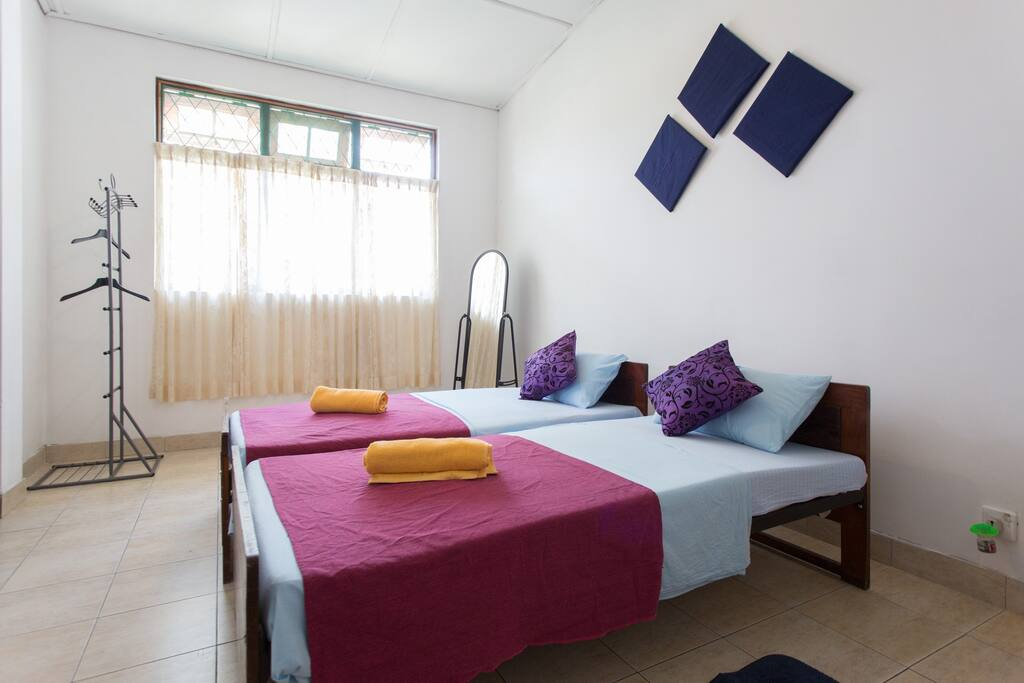 Large room with one double bed a single bed and an attach bath with hot water.