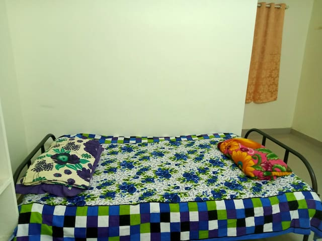 The second bedroom with a single cot