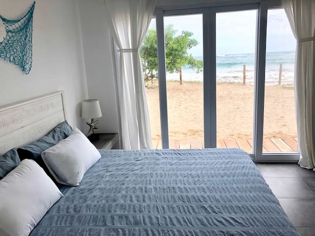 King size bed in the master bedroom with ocean view