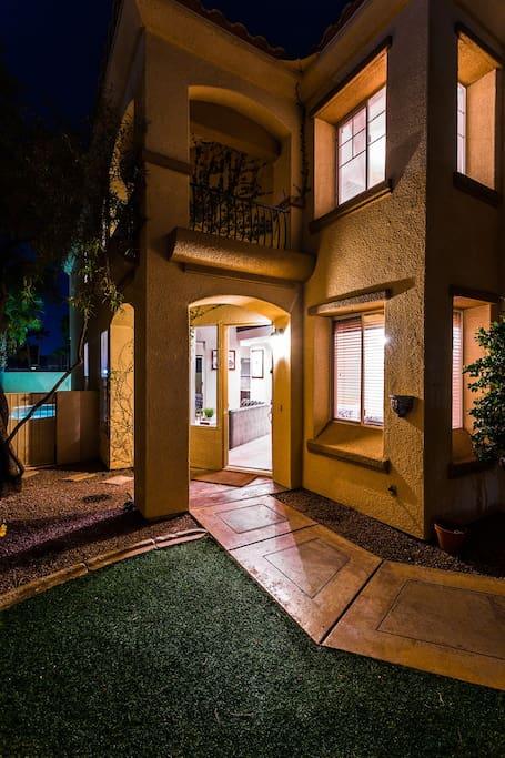 Inviting entryway at night.