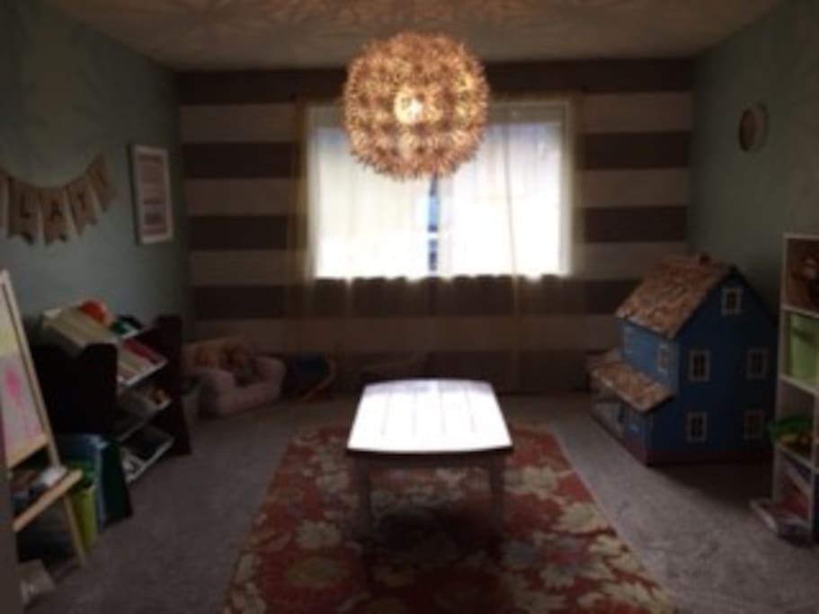 Playroom (table could be moved for air mattress/ sleeping bags)