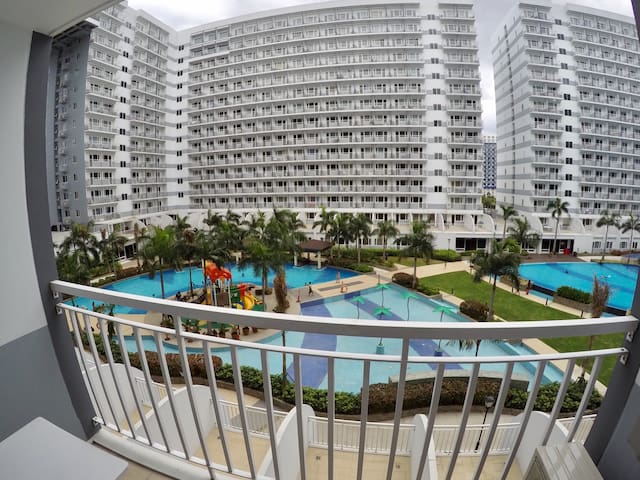 1-BR Unit @ SHELL Residences with WiFi & pool view