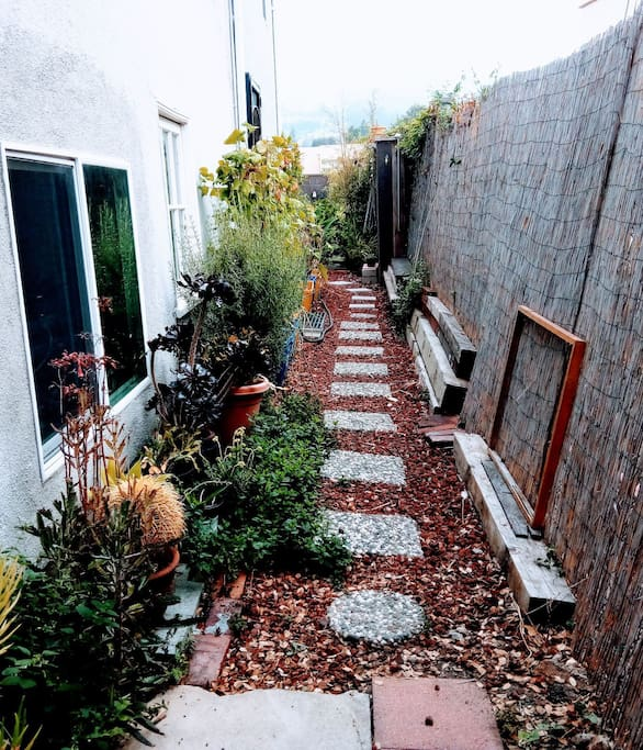 Separate entrance leads to the studio apartment in the back of the property.