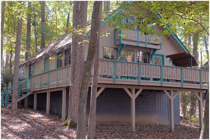 This quiet cabin has a partial lake view and access to the fishing lake. Enjoy putt-putt, tennis, and shooting pool plus much more. Offlake Three Bedroom #53 - Pet Friendly