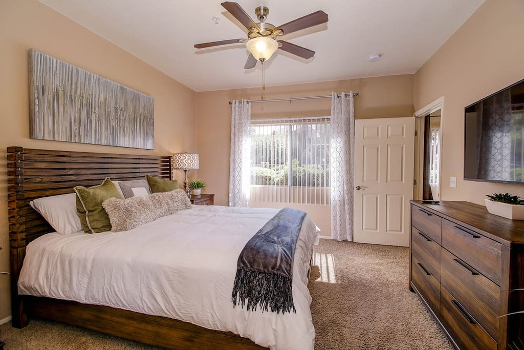 "Relaxing Master Bedroom with King size bed, 50"" 4K HDTV."