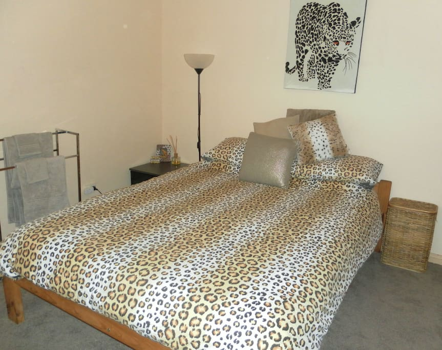 comfortable queen bed sleeps two, also has wardrobe with room to spare for your luggage in this huge 4mx4m room !!!
