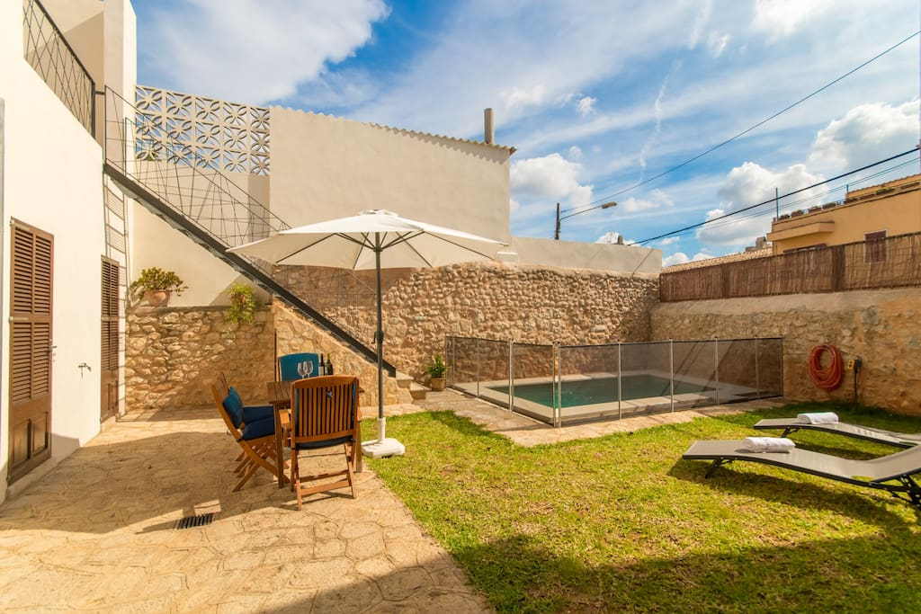 Terrace with garden pool and sun beds