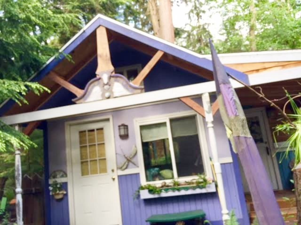 A loving, sweet cottage...eclectic & Purple!