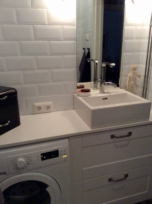 Nice bathroom with  rain shower. Washing machine and hair dryer also on your use.