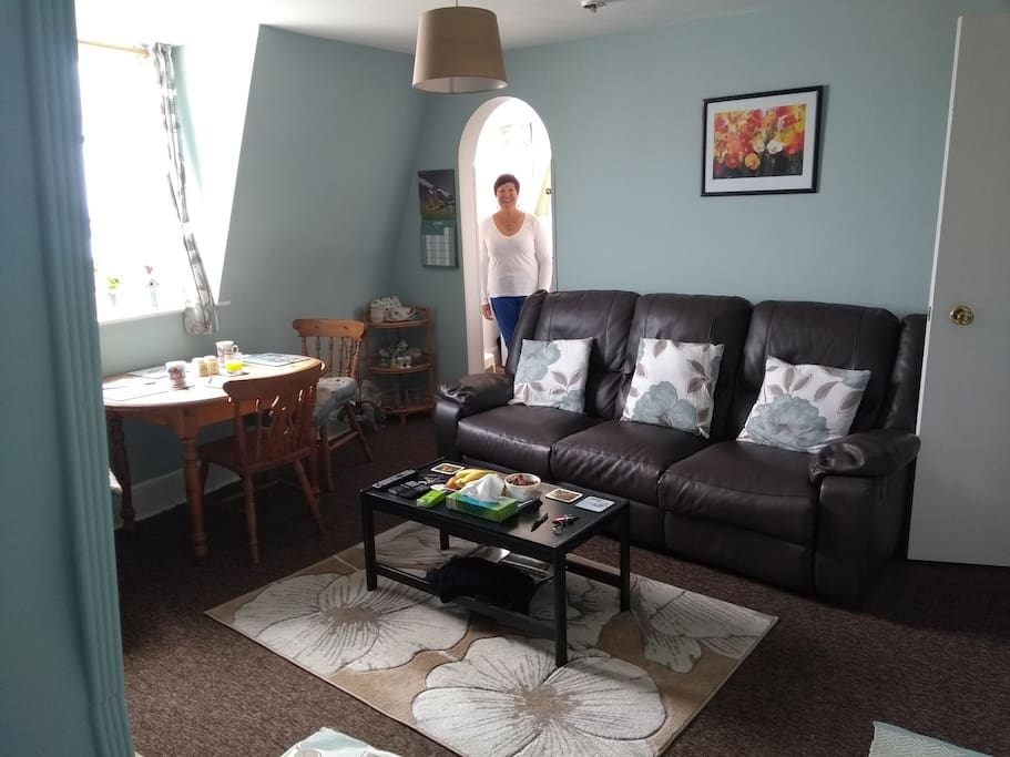 Living room with your friendly host, Wendy to welcome you