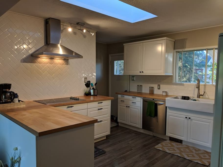 Totally renovated, brand new kitchen with stainless steel appliances, butcher block  countertops and plenty of room for cooking up a feast