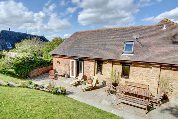 Converted barn with excellent wooden beams, high ceiling and a cosy terrace