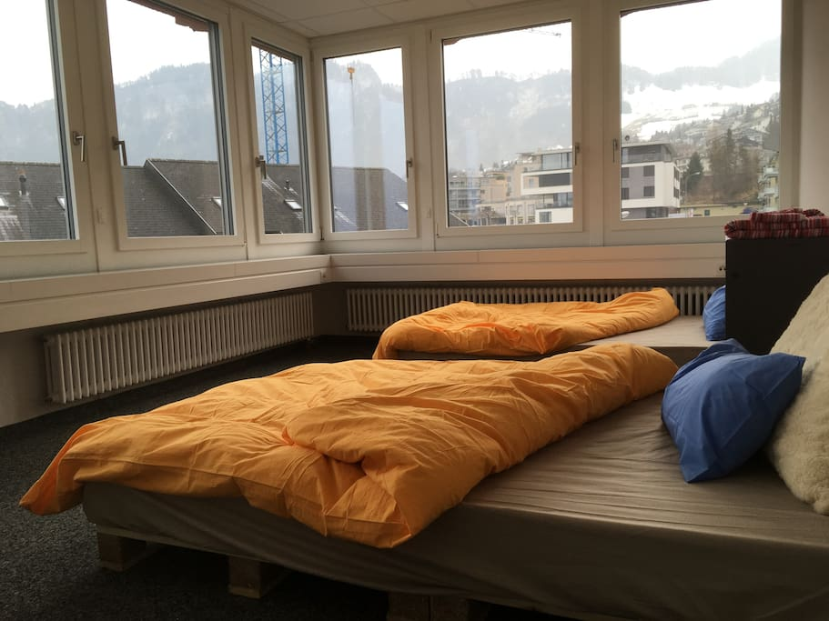 Room has 2 large single beds, table and shelf for clothes