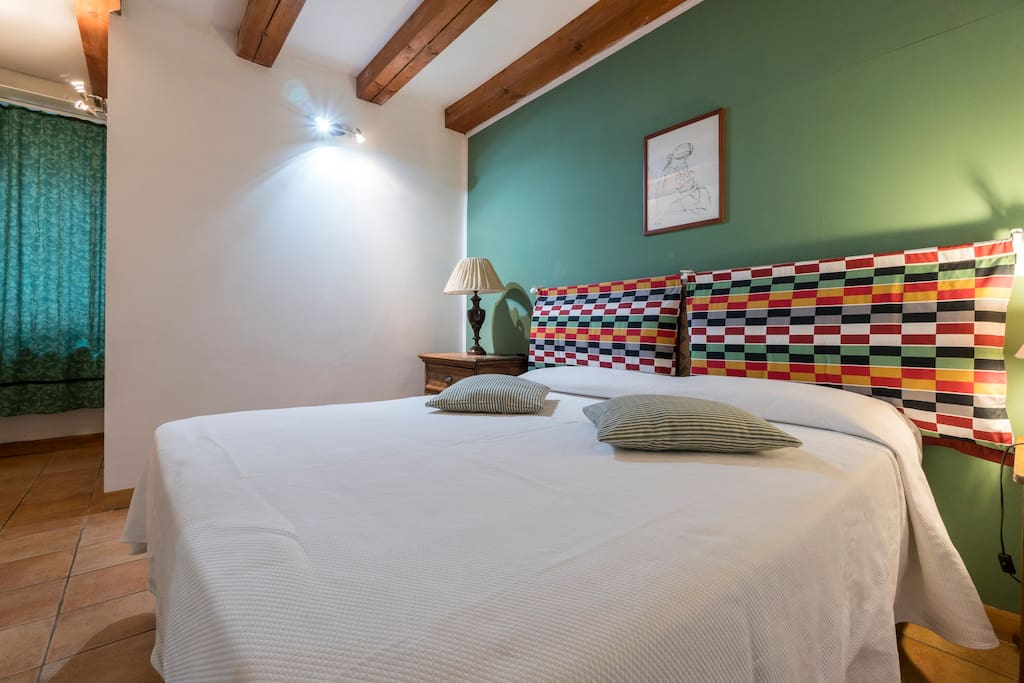 Comfy and spacious bedroom with double bed