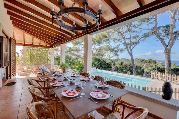 Villa Enderrocat with sea views, garden, lounge areas, and pool