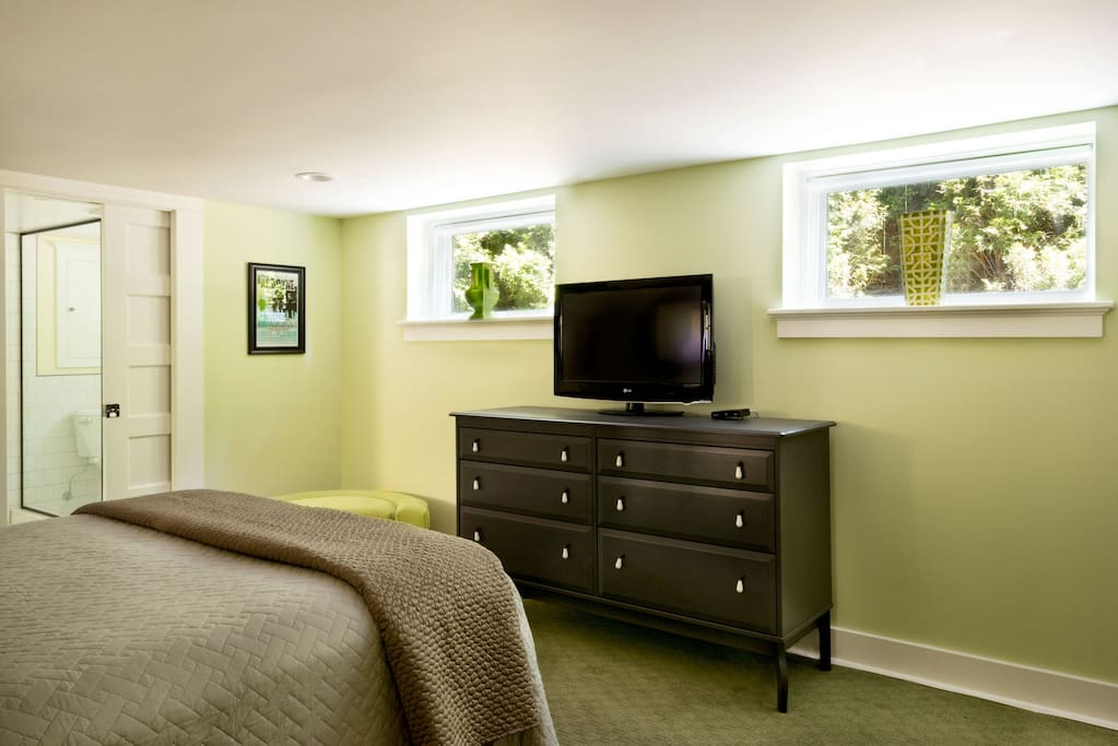 TV and large chest of drawers with sound bar HDTV