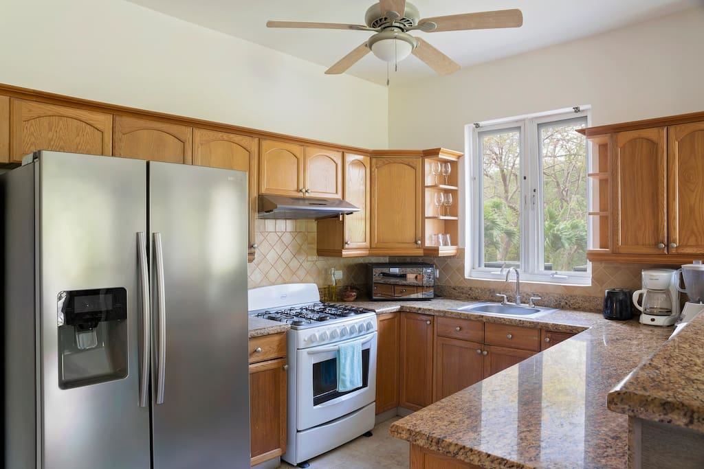 Full kitchen with stainless appliances, coffee maker, blender, microwave.