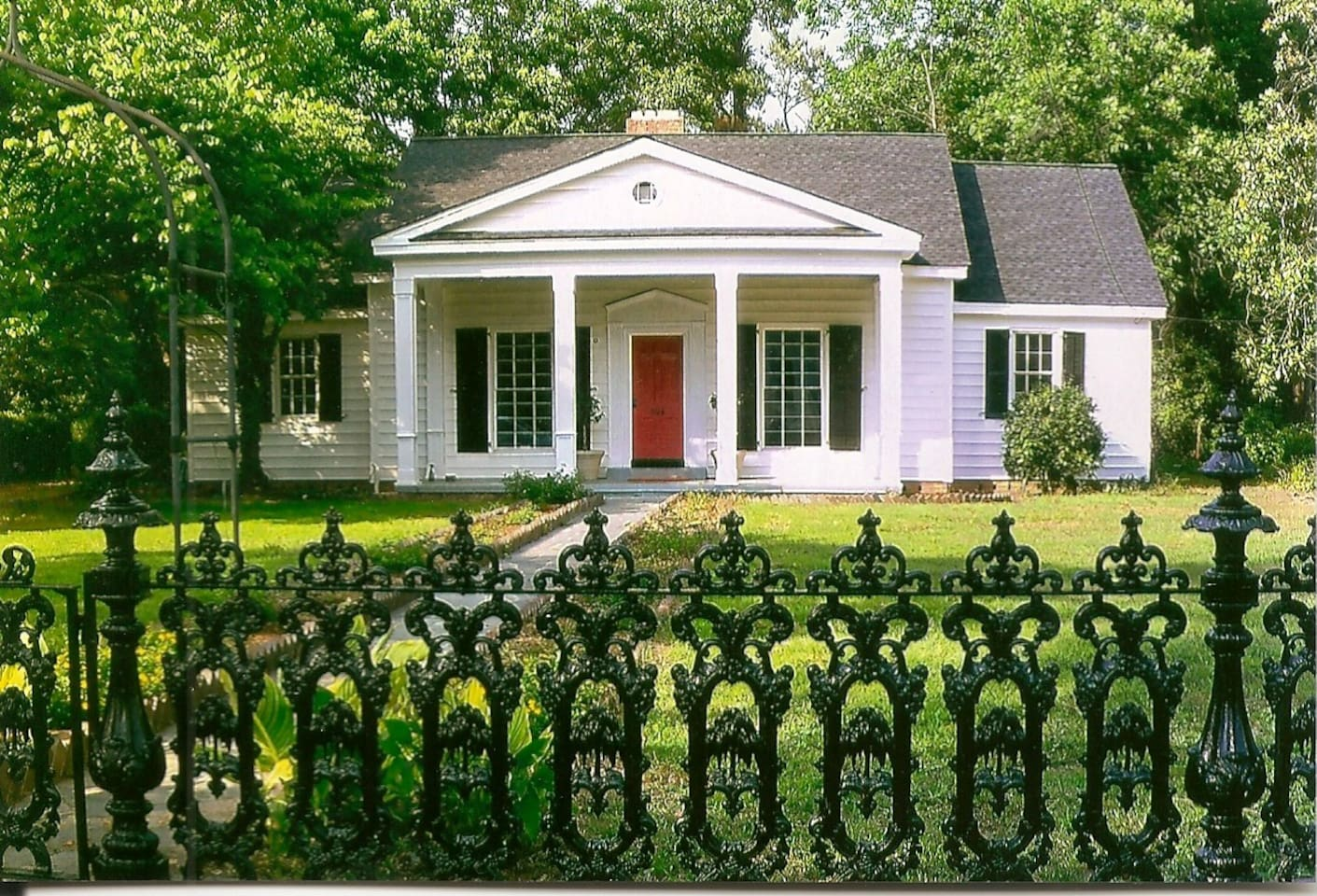 Classical Design home with Wrought Iron Fence Facade