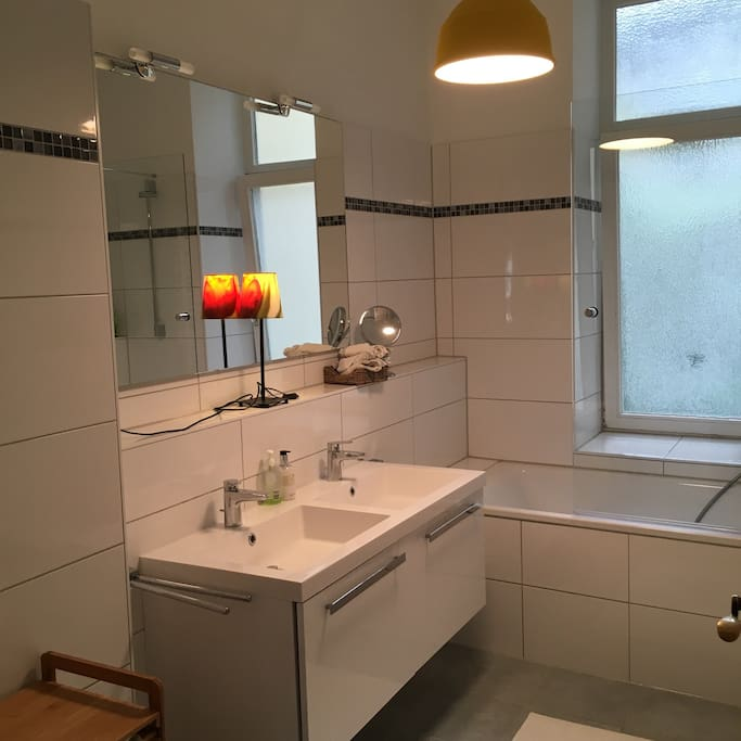 Brand new bathroom with toilet and bath cube and a big window. Towels are provided. Hairdryer as well.