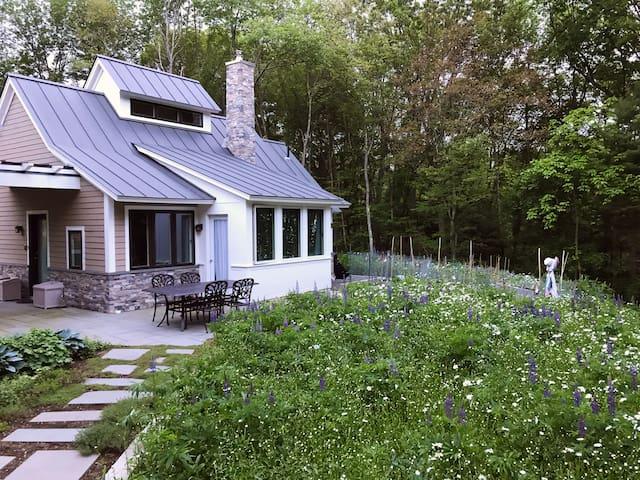 During the summer season, an extensive wildflower garden surrounds Hummingbird Cottage.
