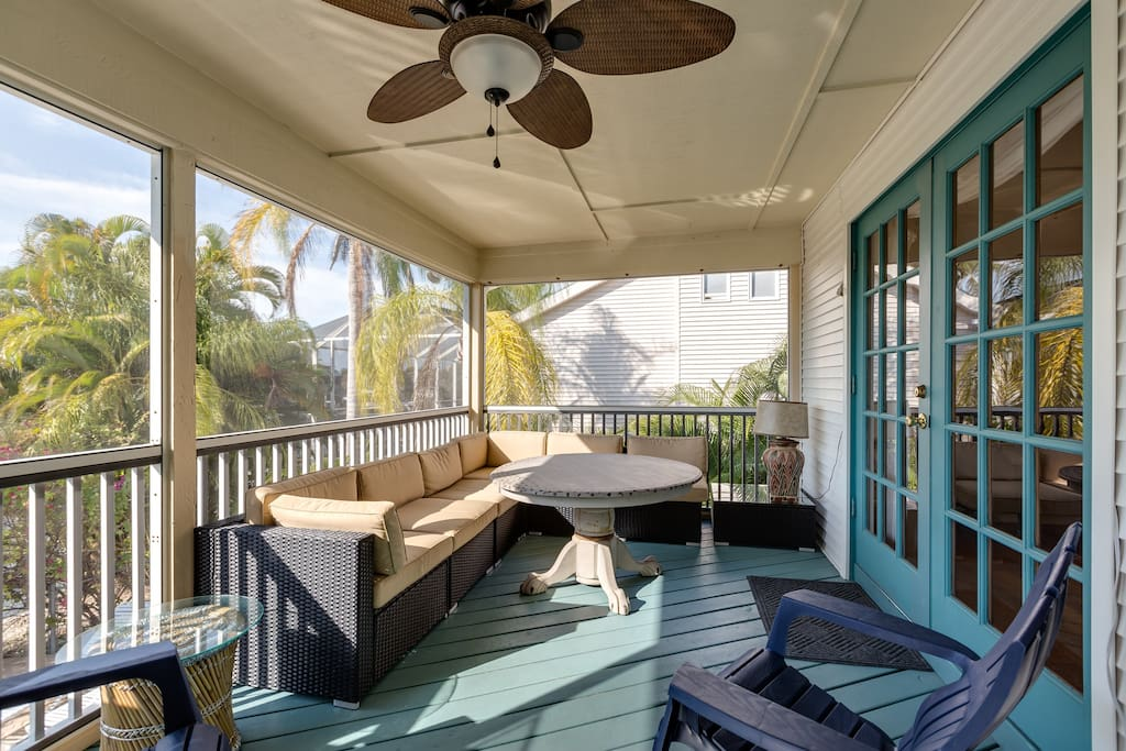 A sunny screened-in balcony overlooks the pool.