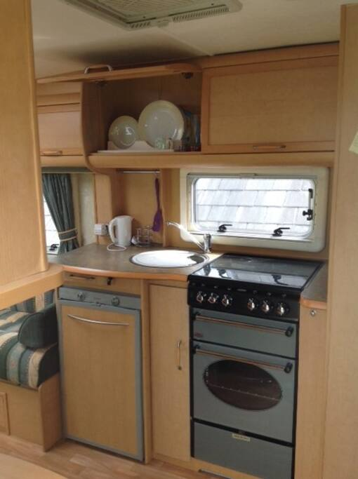 Kitchen area with gas cooker, sink and good sized fridge
