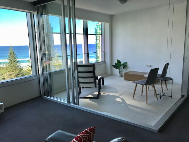 Enclosed glass balcony with large sliding windows so you can hear the ocean.