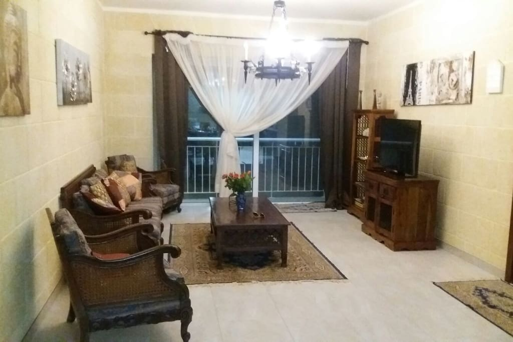 Living-room is very spacious and comfortable. With a nice long balcony, overlooking a sweet village street.