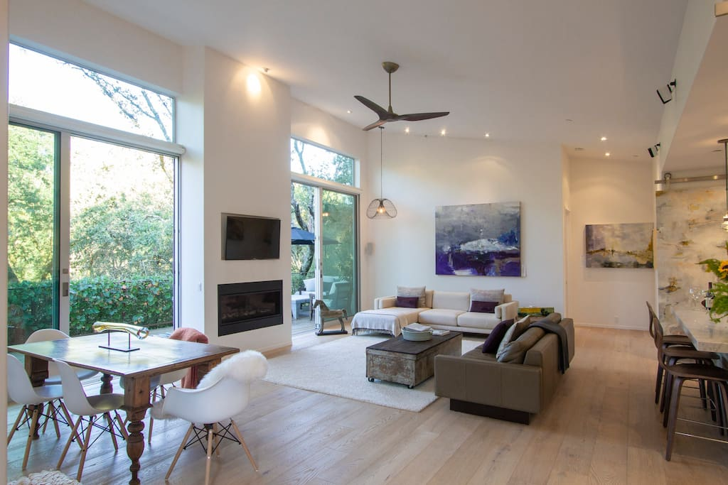 """Large Living room with 15""""ceiling opens to large deck."""