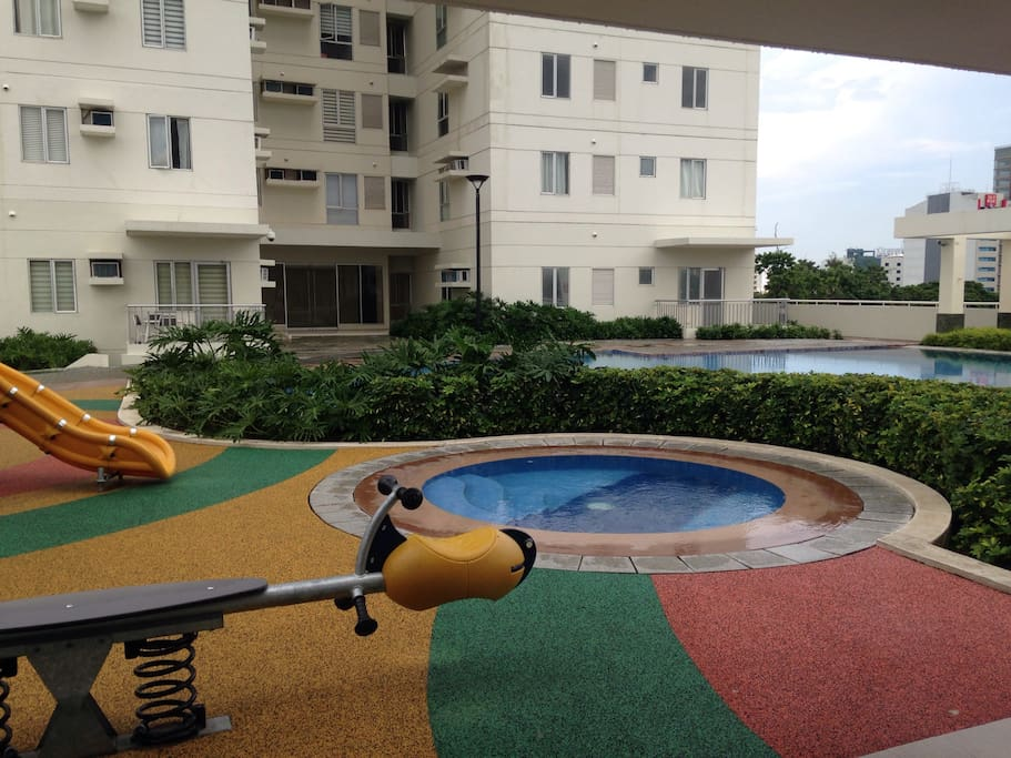 kiddie pool with slide at the side