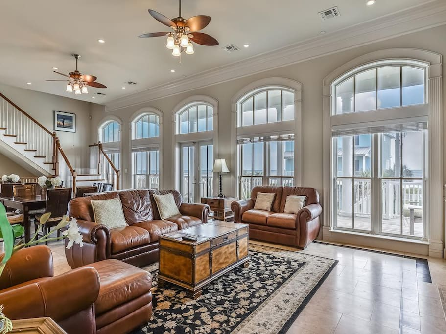 Gorgeous living room afloat to ceiling windows throughout