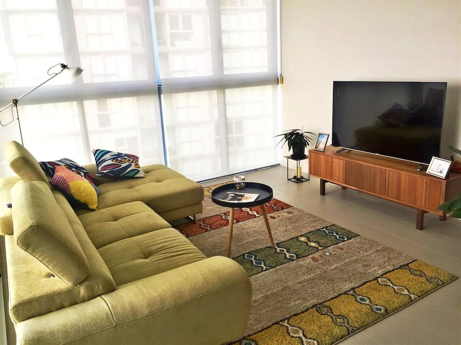 Spacious living area with 55inch 4K TV
