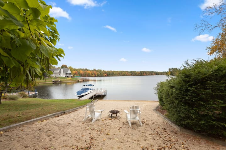 Idyllic lakefront home with 4 bedrooms, game room, private beach, and boat dock