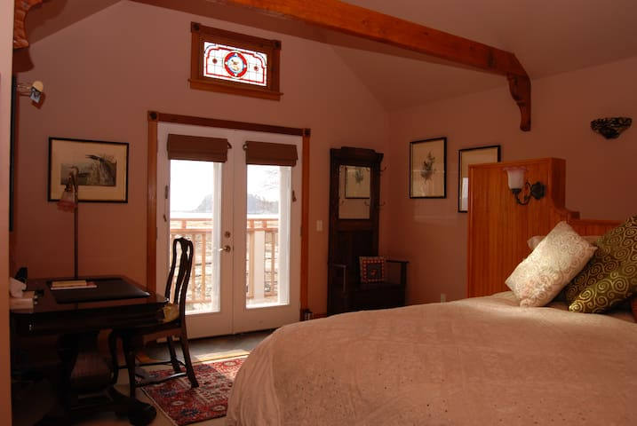 """King sized bed, 42"""" flat screen TV and 2-person air-jet hydro therapy tub upstairs."""