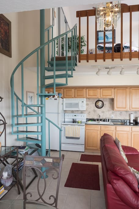 Split level duplex with separate bedroom on top floor with another second private balcony.