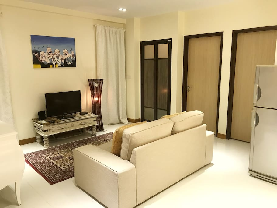 Living area with digital tv and adjoining bathroom, to relax in a resort feel environment