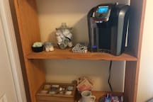 Coffee, tea, and snack station that includes a variety of healthy snacks as well as herbal and black teas.