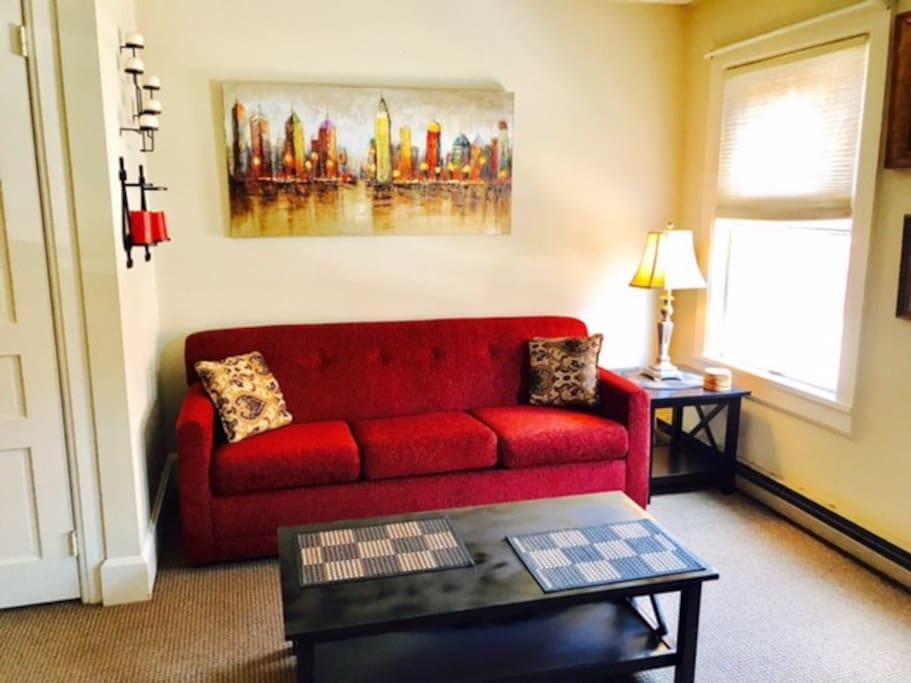 living room with sleeper sofa and plenty of sunlight