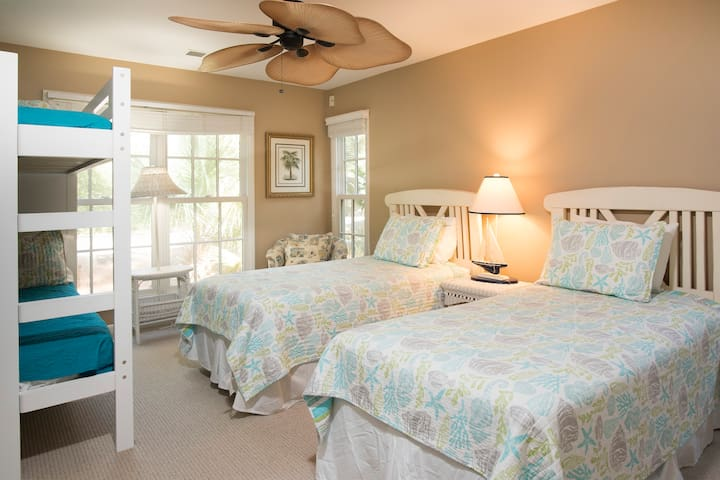Guest bedroom, with two twin beds as well as a bunk bed, there's a place for everyone to rest their head.
