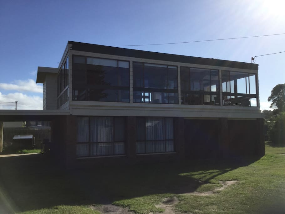 Large family beach house with extensive outdoor area and room for cars and plenty of space for the kids to play in a secure fully fenced garden