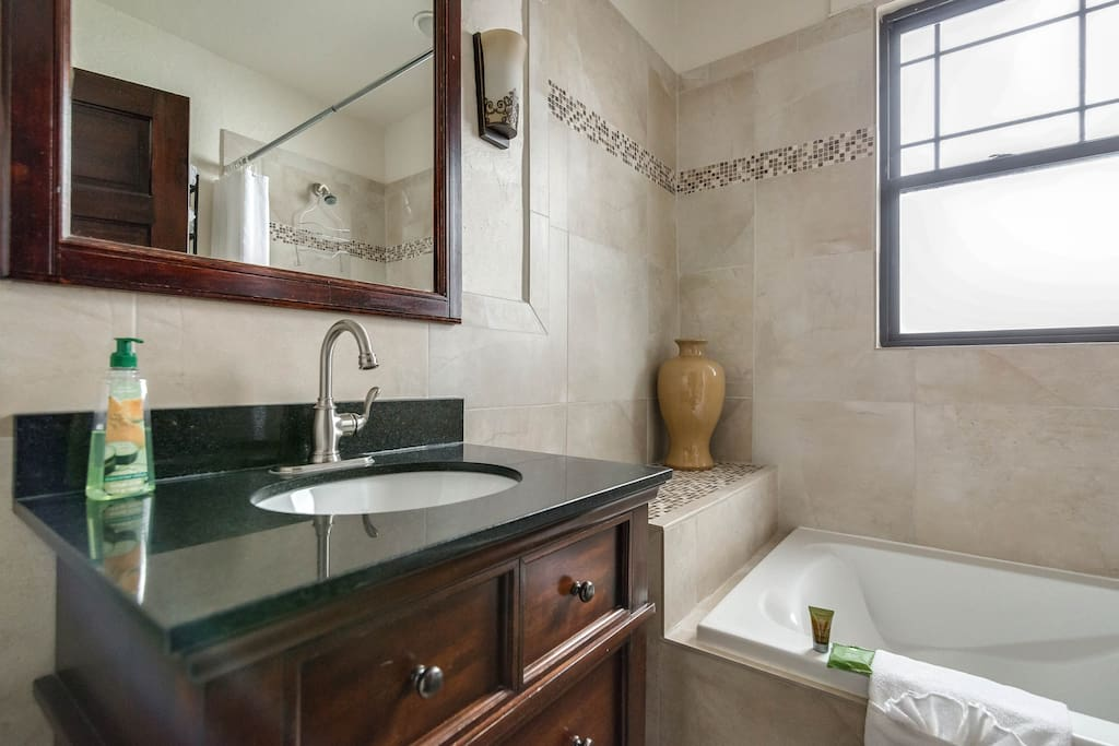 newly remodeled bathroom with large soaker tub