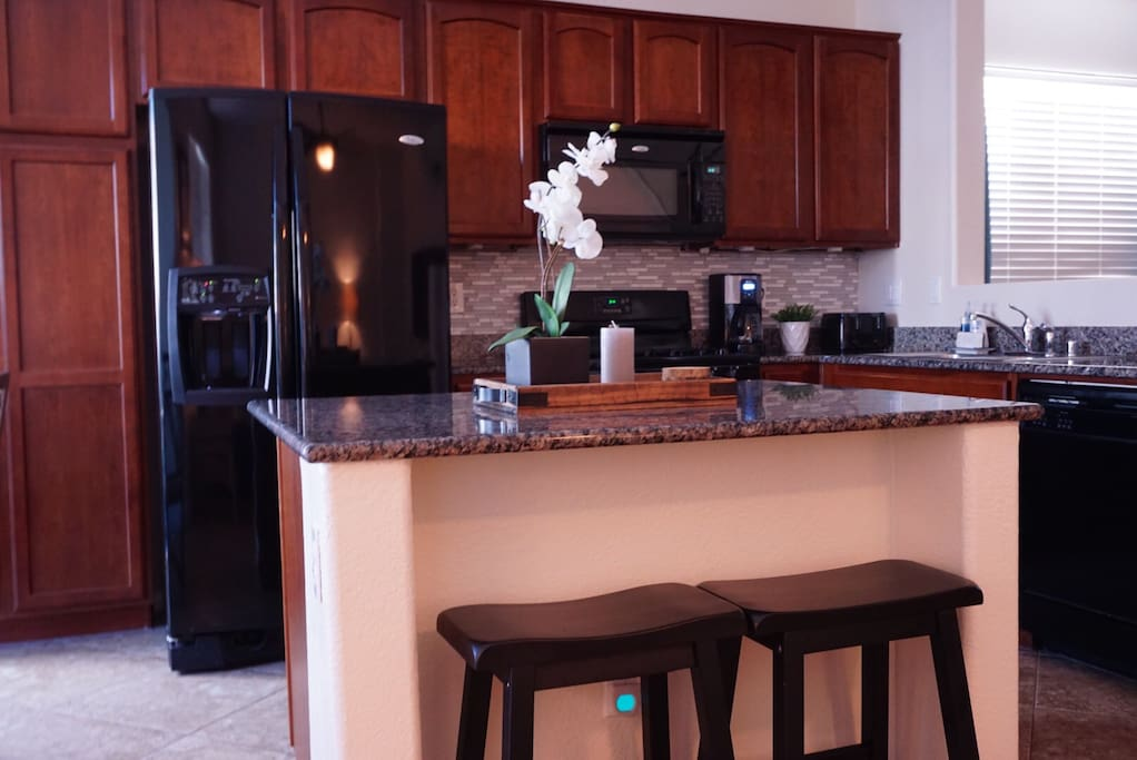 Kitchen: A home away from home, the kitchen has a toaster, rice cooker, and it's stocked with cookware and dinnerware.